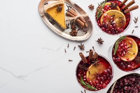 top view of christmas cocktails with orange, pomegranate, cinnamon, frozen  cranberry and pie Stok Fotoğraf - 133845881