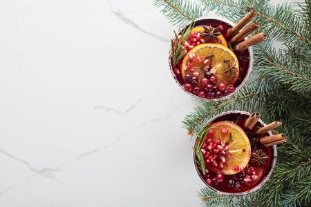 top view of christmas cocktails with orange, pomegranate, cinnamon Stok Fotoğraf - 133845913