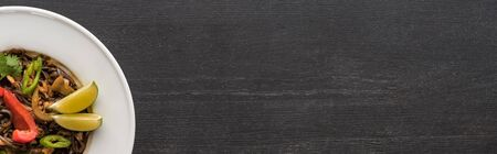 top view of meat thai noodles on wooden grey surface, panoramic shot