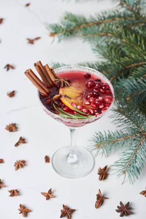 selective focus of christmas cocktail with orange, pomegranate and cinnamon Stok Fotoğraf - 133846477