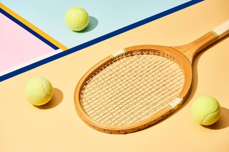 Tennis racket and balls on colorful background with blue lines