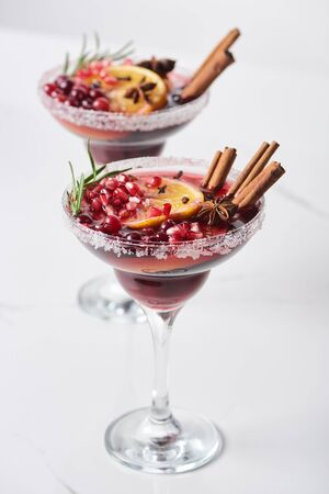 selective focus of christmas cocktail with orange, pomegranate, cinnamon Stok Fotoğraf - 133845963