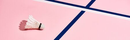 Shuttlecock for badminton on pink surface with blue lines, panoramic shot Stock Photo