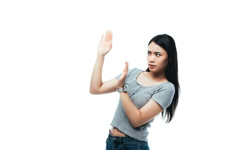 displeased asian girl showing no gesture isolated on white