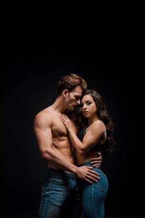 beautiful sensual couple hugging, isolated on black Stock Photo