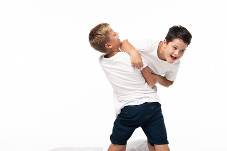 two brothers having fun while imitating fighting isolated on white