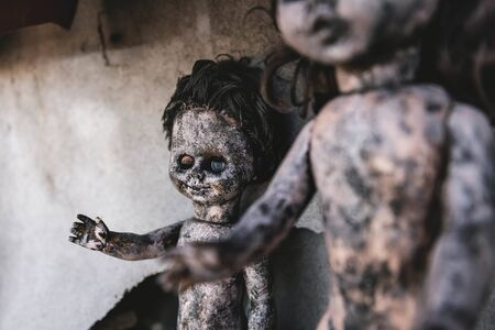 selective focus of scary and burnt baby dolls, post apocalyptic concept