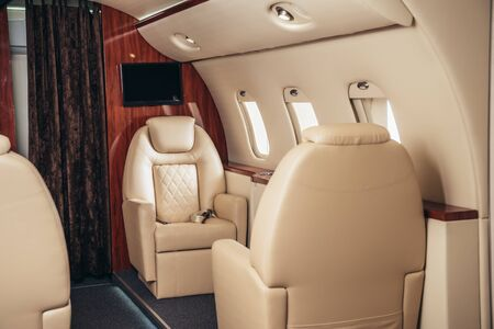 luxury, comfortable and modern cabin of private plane 스톡 콘텐츠