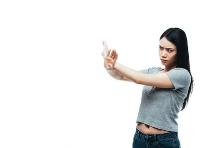 displeased asian girl showing stop gesture isolated on white Stock Photo