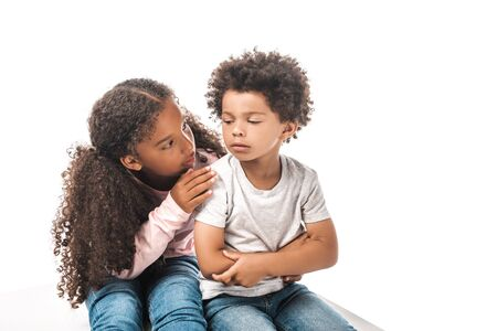 attentive african american sister calming down upset brother isolated on white
