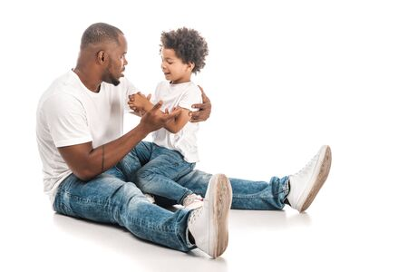 handsome african american man talking to adorable son on white background Stok Fotoğraf