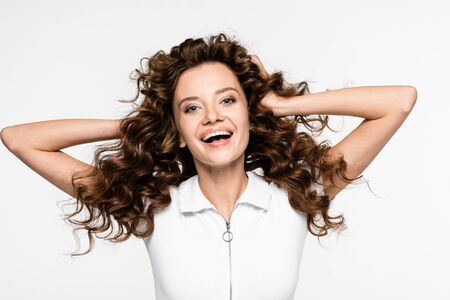 beautiful smiling curly girl in white t-shirt, isolated on white Reklamní fotografie