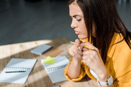 thoughtful female freelancer working in home office Reklamní fotografie