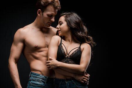 beautiful sexy couple hugging, isolated on black Stock Photo