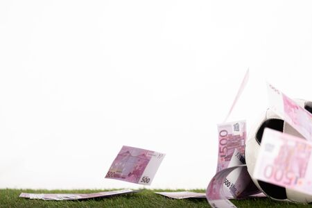 soccer ball near flying euro banknotes isolated on white, sports betting concept Banque d'images