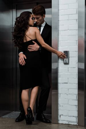 beautiful sensual couple hugging and flirting near lift