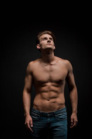 handsome sensual man posing isolated on black