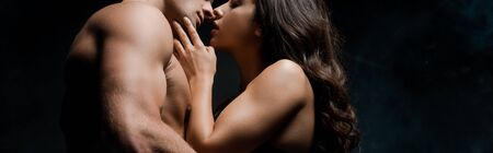 beautiful seductive couple hugging and kissing, isolated on black Stock Photo