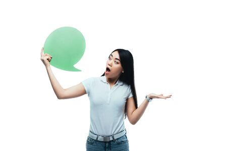 socked asian girl looking at green blank speech bubble isolated on white Stock Photo