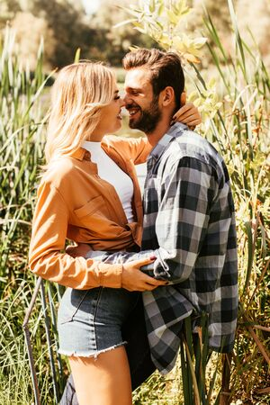 happy young couple hugging in thicket of sedge Banque d'images