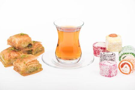cup of tea near baklava, turkish delight isolated on white Stock Photo