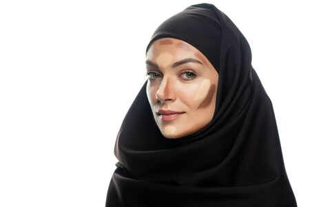 young Muslim woman in hijab with facial contouring isolated on white Stock fotó