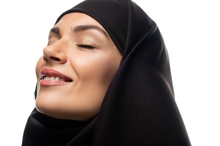 attractive smiling young Muslim woman in hijab with closed eyes isolated on white Stock fotó