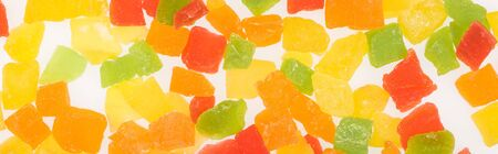 top view of colorful delicious candied fruit isolated on white, panoramic shot