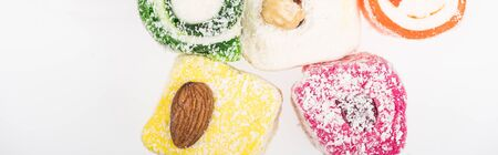 top view of assorted delicious turkish delight in coconut flakes isolated on white, panoramic shot