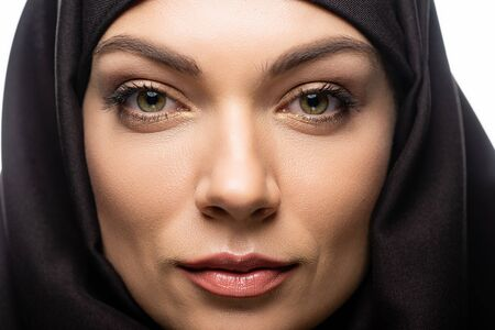 close up view of beautiful young Muslim woman in hijab isolated on white