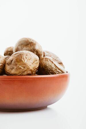 delicious jacket potato in clay bowl on white background Stock Photo