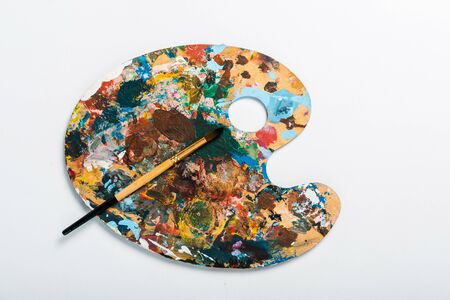 top view of palette with colorful gouache paint isolated on white Banco de Imagens