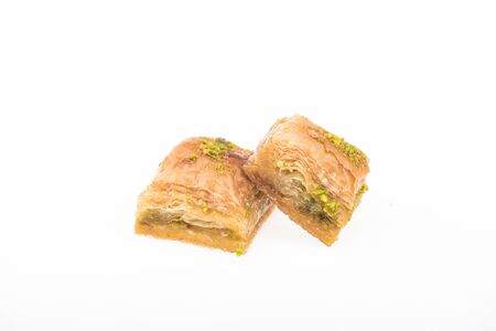 traditional turkish honey baklava with nuts isolated on white Stock Photo