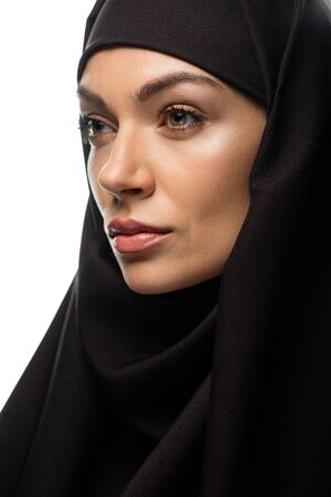 attractive young Muslim woman in hijab looking away isolated on white