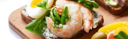 panoramic shot of smorrebrod sandwich with tasty shrimps on white Stock Photo