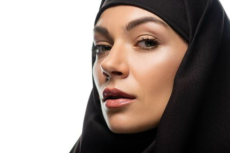 attractive young Muslim woman in hijab looking at camera isolated on white Stock fotó