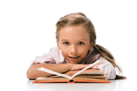 cute and happy kid smiling near book on white