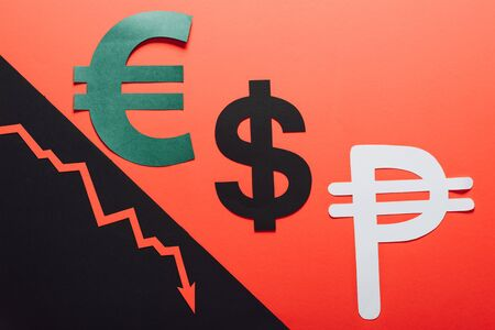 euro, dollar and peso symbols, and recession arrow on red and black background divided by sloping line Stock fotó