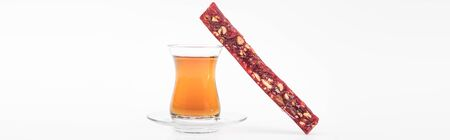 sweet turkish delight with nuts and tea isolated on white, panoramic shot