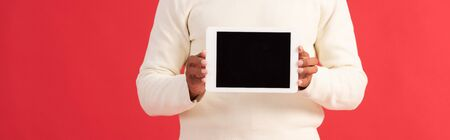 panoramic shot of man holding digital tablet with blank screen Reklamní fotografie
