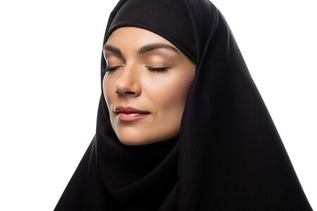 attractive young Muslim woman in hijab with closed eyes isolated on white Stock fotó