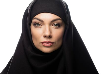 beautiful young Muslim woman in hijab looking at camera isolated on white Stock fotó