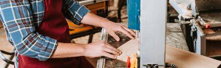 panoramic shot of woodworker using cnc machine