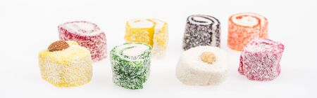 assorted delicious turkish delight in coconut flakes isolated on white, panoramic shot