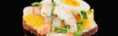 panoramic shot of tasty shrimps on smorrebrod sandwich on black Stock Photo