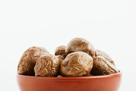 delicious jacket potato in clay bowl isolated on white Stock Photo