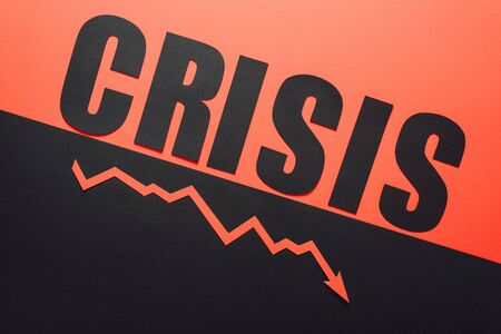 to view of word crisis and recession arrow on black and red background divided by sloping line