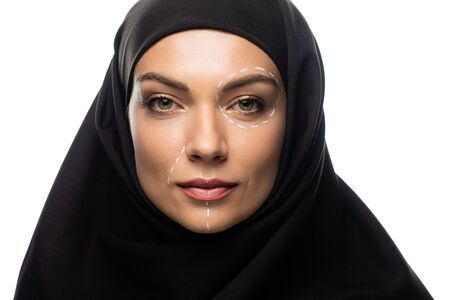 young Muslim woman in hijab having marks on face for plastic surgery isolated on white