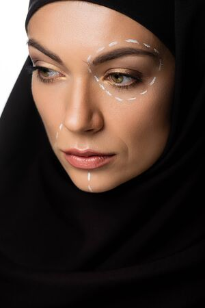 young Muslim woman in hijab with plastic surgery marks on face isolated on white