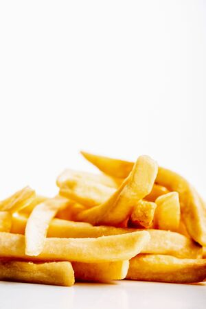 heap of fresh golden french fries isolated on white Stock Photo